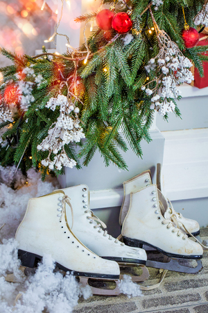 Christmas gifts, skates, are carried under the tree.