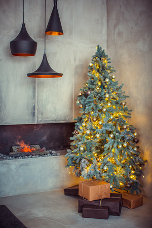 fireplace living room: Beautiful holiday decorated room with Christmas tree with presents under it. Stock Photo