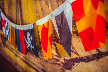 Sea flags with pirate hanging on the wall Stock Photo