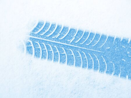 snow tires: blue tire on white snow