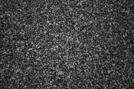 black stones: Black stones on a Black sand beach as a background. Stock Photo