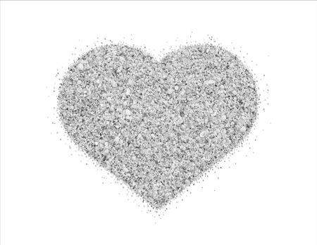 heart on beach sand of small shells, heart symbol Stock Photo