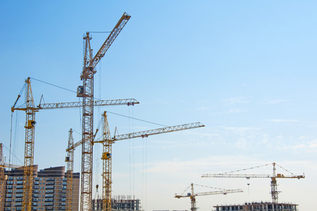 high tech: Tower cranes on a background of blue sky