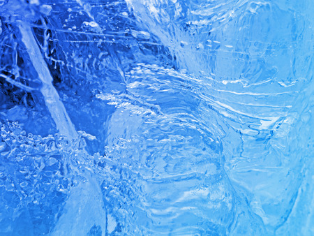 Blue ice. Abstract ice texture. Nature background.
