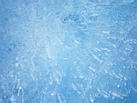 Blue ice. Abstract ice texture. Nature background.                                      Stock Photo