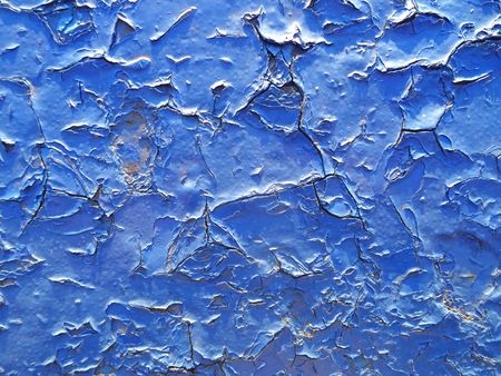 Crack and damage on painted texture in navy blue tone.