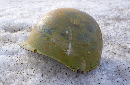 soldier's helmet lying on the snow in the afternoon Stock Photo - 120654274