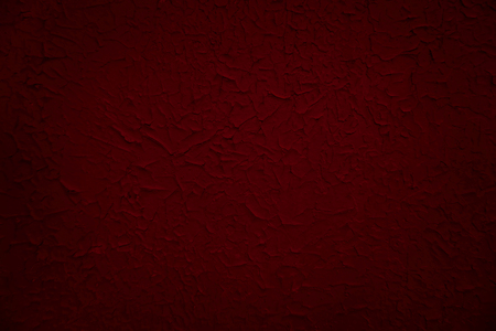 Red painted grunge wall texture. Old surface colored blue paint