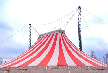 two Large Peaks On Red And White Striped Circus Big Top Tent