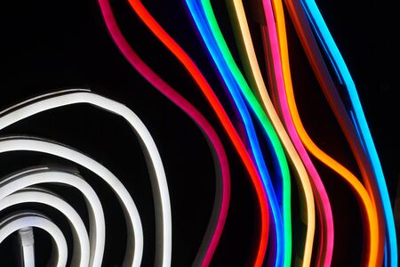 image of pink blue wavy neon lines, ultraviolet light abstract background