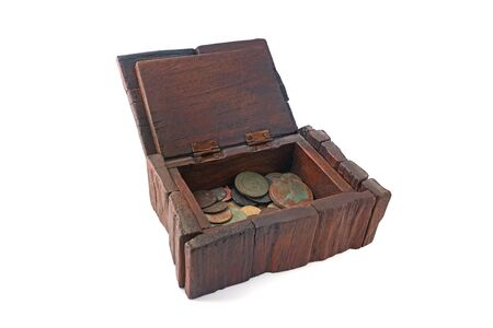 Old wooden box on white background with old coins. Isolated brown box. Standard-Bild
