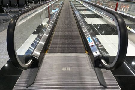 long moving walkways without the people at the international airport