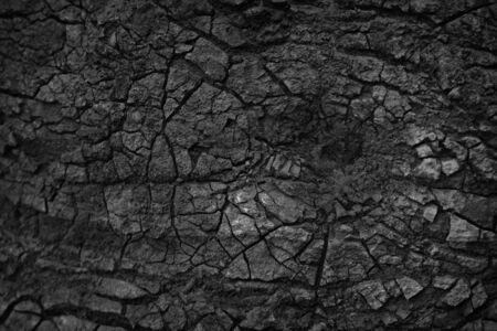 Dry ground texture with deep. Crack lava background.