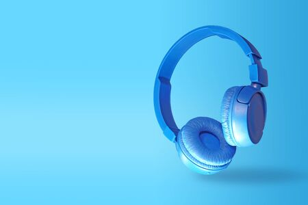 Blue headphones isolated on a blue