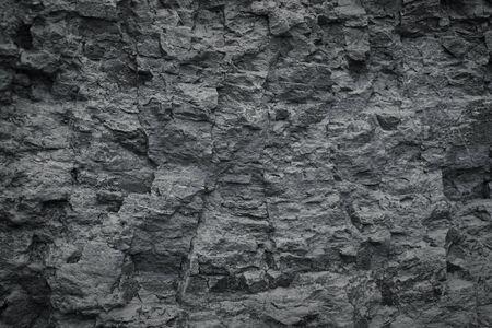 Black Stones texture and background. Dark Rock texture.
