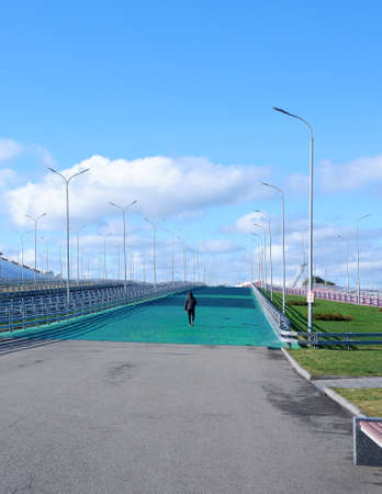 a lone walking man on a giant overpass
