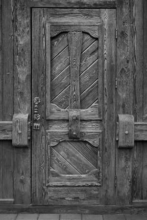 Detail of hinge on old wooden door in historical city
