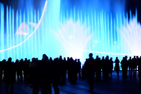 Blurred Silhouettes of people enjoying the fountain show