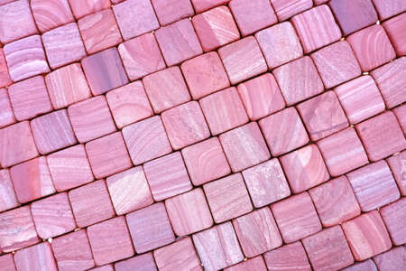 The texture of the paved tile on the bottom of the street. Natural brick squared stone floor