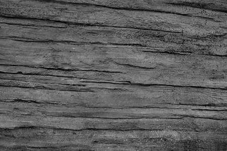 Dark gray paint textured wall closeup. Gray background.