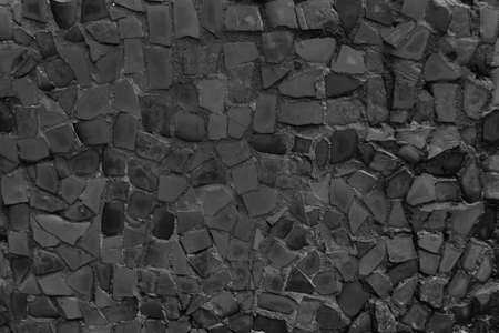 Black mosaic tiles of irregular sizes arranged in a background motif. Space for text. Stock fotó
