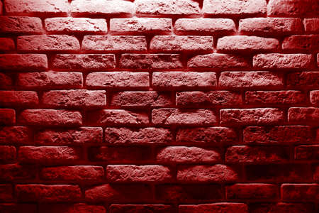Red bricks wall with light spot on center backgrounds