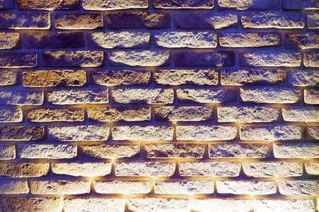 Bricks wall with light spot on center backgrounds Stock fotó