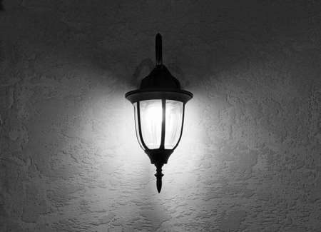 lantern on the wall of the house