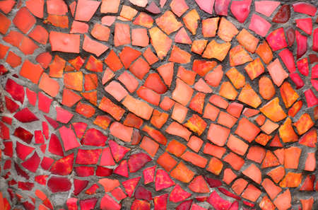 Red mosaic tiles of irregular sizes arranged in a background motif. Space for text. Stock fotó