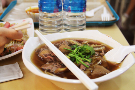 food court: Singaporean beef noodles at a food court