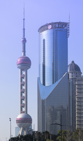 pudong district: SHANGHAI-FEB. 9 ,: Oriental Pearl Tower on FEB. 9, 2015 in Shanghai. The Oriental Pearl Tower is a 468 meter TV tower, located at Lujiazui in Pudong district, by the side of Huangpu River.