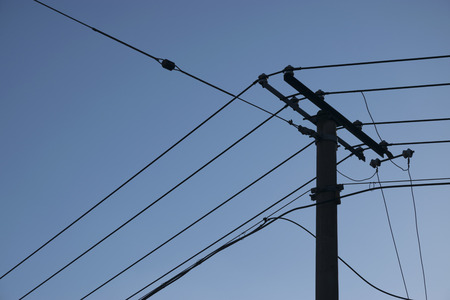 electrical wire: Sketch of an electricity pole with blue sky background.