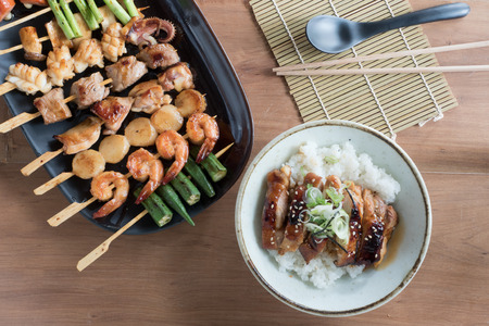 Yakitori: Japanese grilled bite-sized food on skewers and chicken teriyaki rice bowl