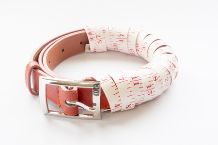 brown belt isolated roll with measuring tape on white background