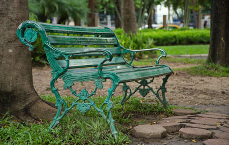A bench at the rearmost of the Chatuchak Park, Bangkok, Thailand. There is pushing up a reminiscent of loneliness even the park is situated in the one of busiest area of city.