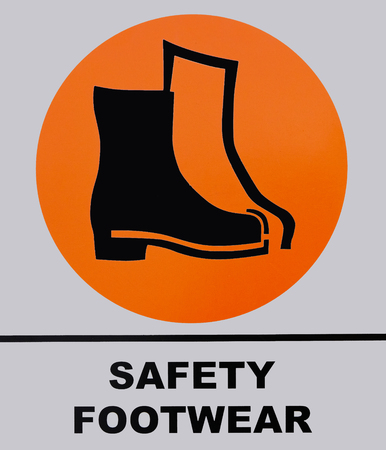 Safety shoes footwear sign isolated on white background. This photo was taken from the sign board, it is not an illustration work.