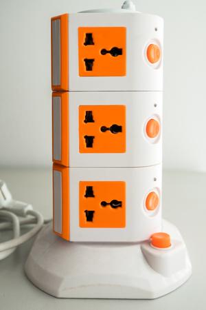 Portable multiple orange plug sockets. Stock Photo