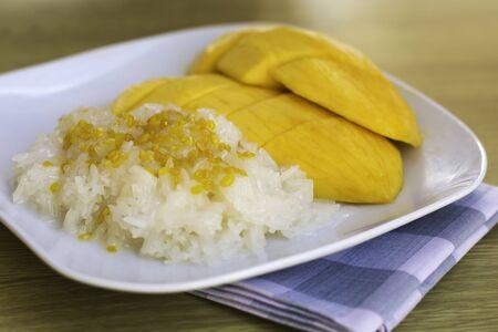 Thai dessert, Mango with sticky rice close up photo