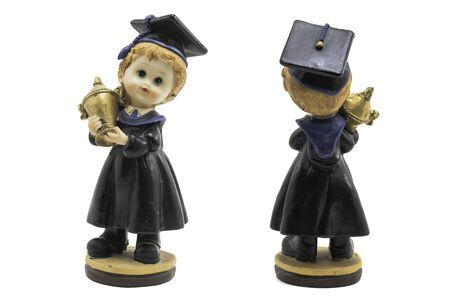 succeeding: Man graduation doll