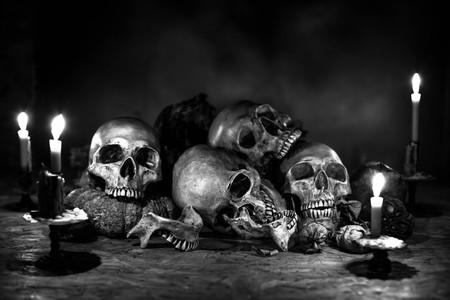 marginalized: Skull and candle still sl,black and white