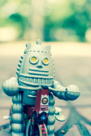 Retro robot toy, vintage color style, vintage tone background.
