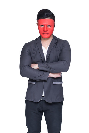 dramatic characters: Businessman with red mask concept, isolated on white background Stock Photo