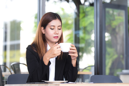 Portrait beautiful asia business people or businesswoman take a break with coffee cup, Portrait business concept.