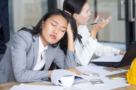 Asian businesswoman sleeping while work, Portrait business concept.