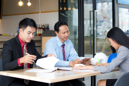 Asian business people or businessman and businesswoman have a team meeting, Portrait business team concept. 스톡 콘텐츠