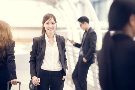 Asian Businesswoman standing and smile at the city, portrait business concept, vintage color tone.