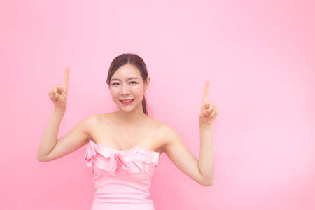 Korean woman fashion set sweet pink sexy girl, woman with skin care concept, isolated with pink background, 20-30 year old. Stock Photo