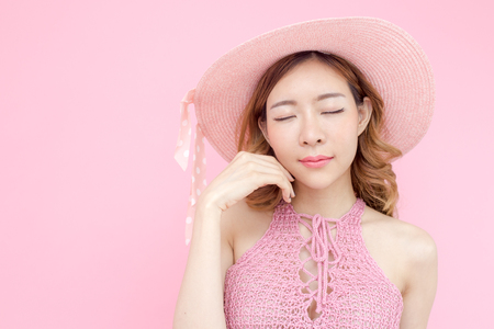 Beautiful korea woman posing at pink background with summer concept, isolated on pink background, 20-30 year old.