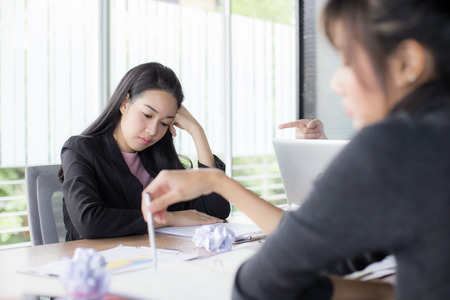 Asian woman working with serious situation at office, woman with stressful concept,  20-30 years old.