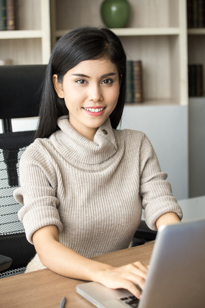 Beautiful young asian woman working at office with happy emotion, woman working concept, 20-30 years old.